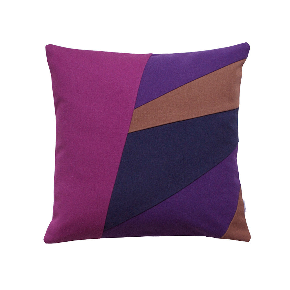 Throw pillow in berry colors with asymmetrical design