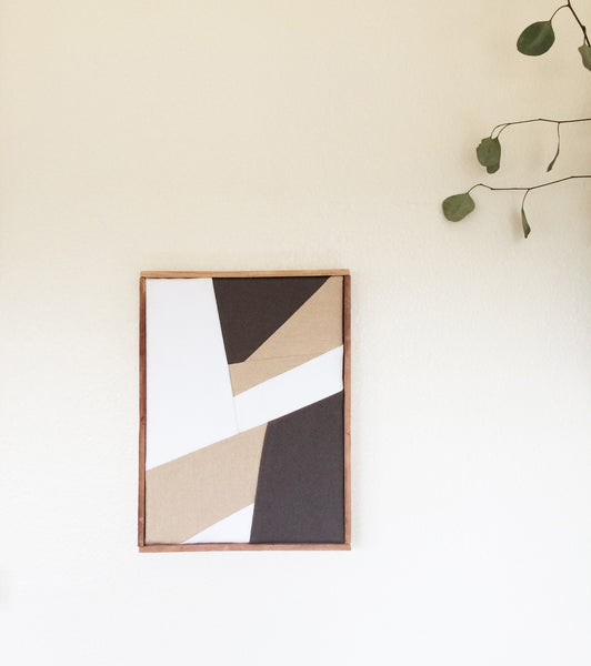 Textile wall art in natural colors and geometric pattern