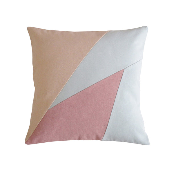 Geometric design pillow in pink, blue, and beige