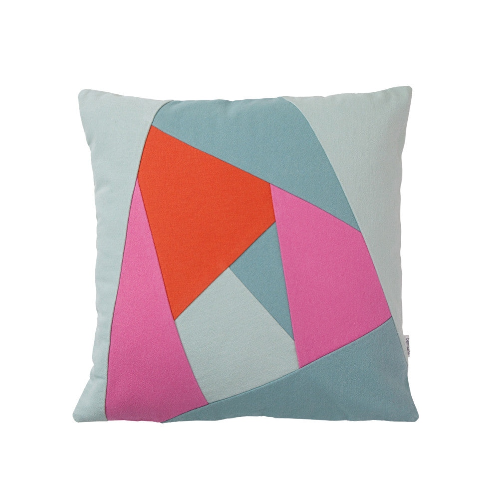 Green and purple throw pillow with geometric pattern