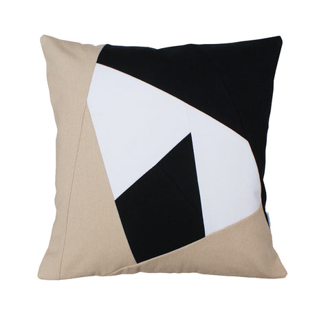 beige, black, and white pillow