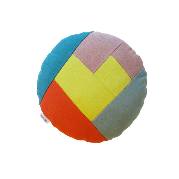Round pillow with colorful front side with a yellow heart in the middle