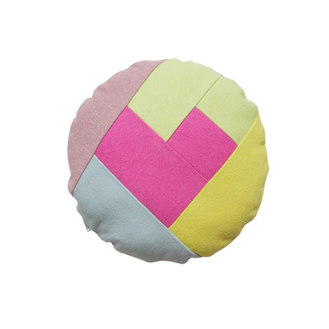 round colorful pillow with pink heart on the front for kids