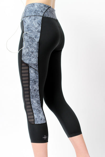 Side of woman wearing She's Got Heart Mesh Capri Leggings by Epidemia Designs