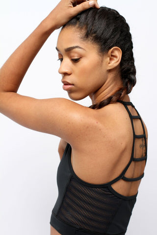 Side view of woman wearing Essential Black Mesh Longline Bra by Epidemia Designs