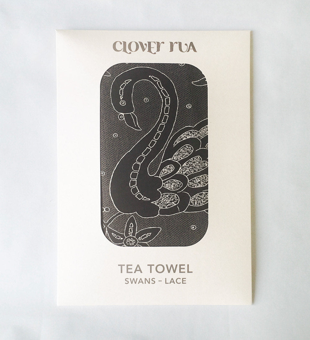 Swans Irish Lace design tea towel, in specially designed packaging.