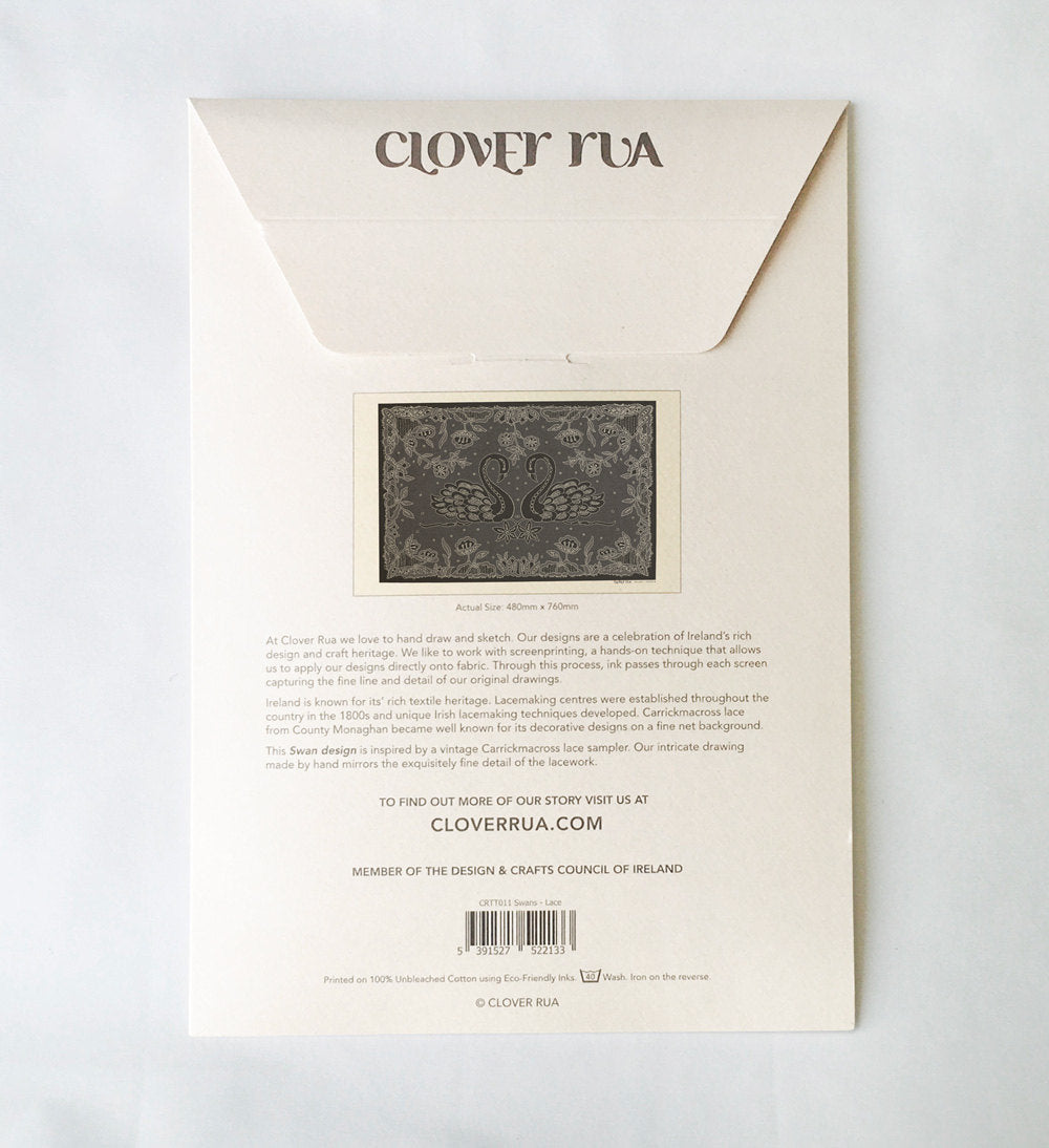 Reverse side of the Swans Irish Lace design tea towel, in specially designed packaging, with design explanation.