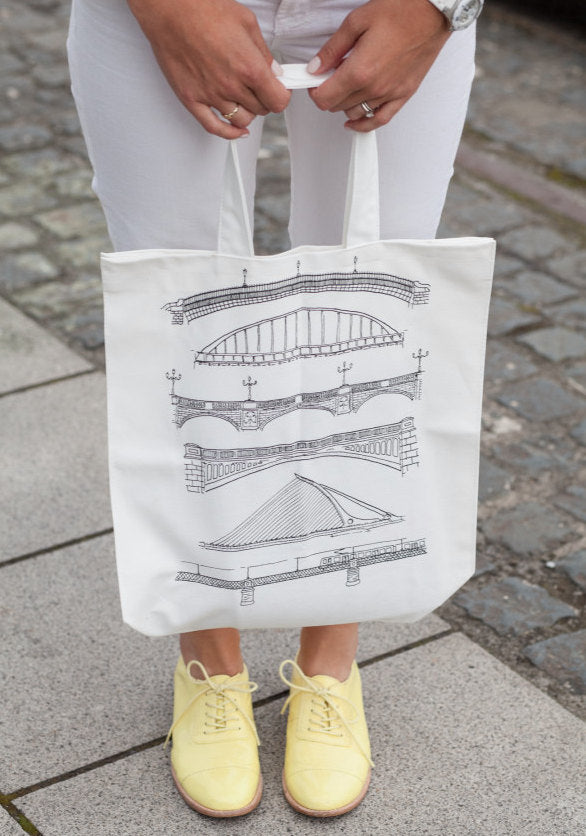 Emily Westbrooks poses with the Dublin Bridges tote, black print on cream.
