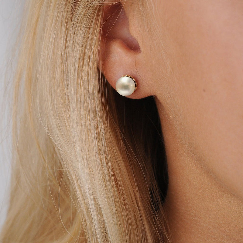 White Pearl Stud Earrings on Model