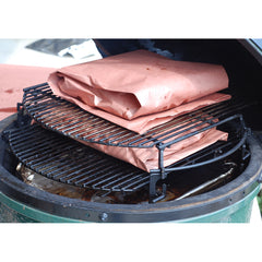 wrapped beef ribs in butcher paper in large big green egg