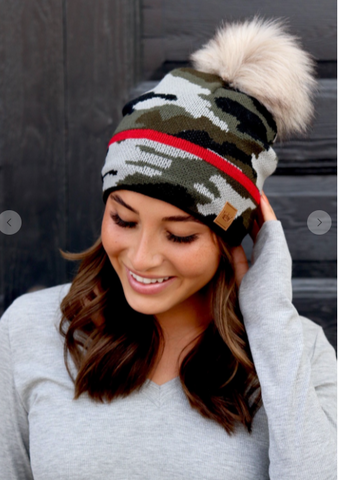 Women's Camo knit hat with pom accent.