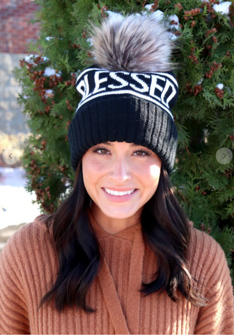 Women's Blessed knit hat with pom accent.