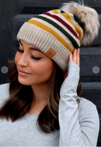 Women's Fleece lined striped hat with pom.