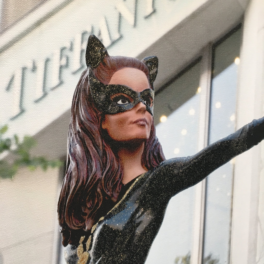 Close-up of the Catwoman's face. She looks like Barbie, but with brown hair, is wearing a mask, and cat ears.