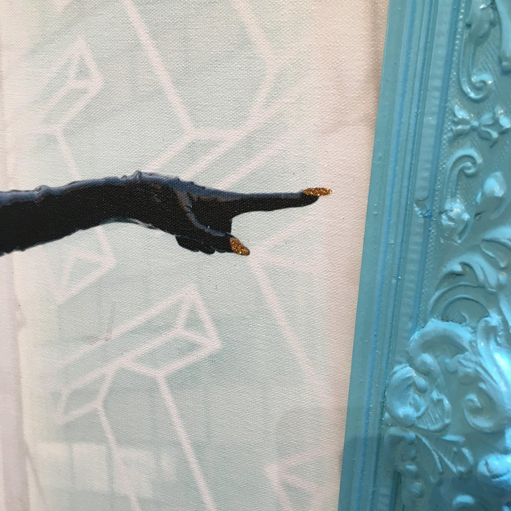 Detail of the Catwoman figure's sparkling fingernails on the hand she is using to point.