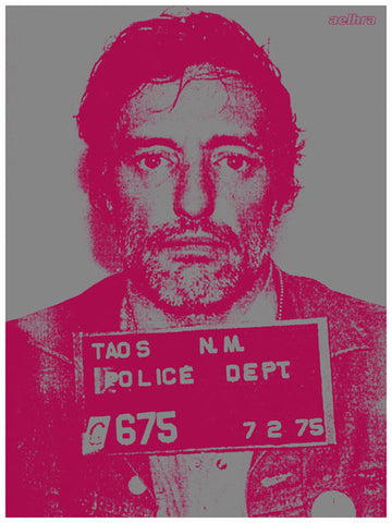 Pink coloured Dennis Hopper mugshot. Staring at camera, holding police board.