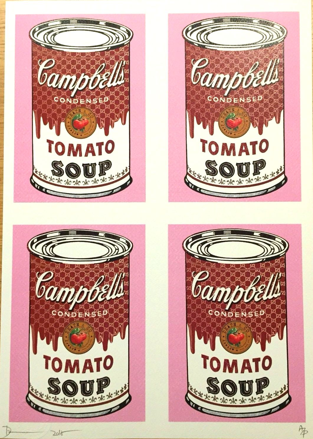 Image of a soup can repeated 4 times. It is a Campbell's tomato soup can on a pink background. The print is signed and numbered on the bottom
