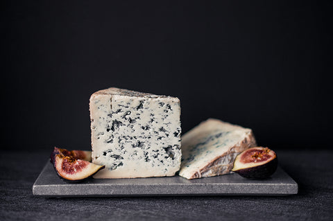 Bleu D'Auvergne french blue cheese in a stack and cut from the cheese wheel