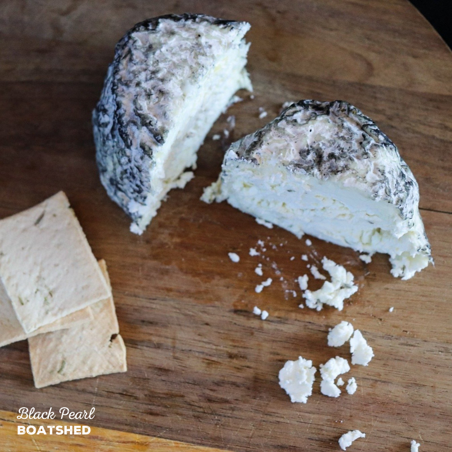 Indulgent fresh cheese dusted in ash, made by BoatShed.
