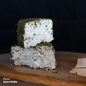 Oasis, a fresh cheese with a coating of various herbs such as Lemon Myrtle, made by BoatShed.