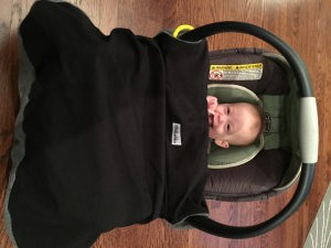 Cover snapped over Chicco infant car seat