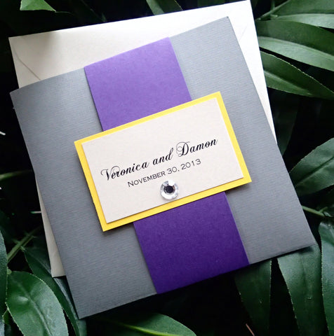 Signature pocket fold invitation in grey, purple, ivory and yellow