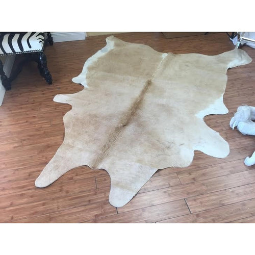 COWHIDE - NATURAL SOLID CARAMEL - Trophy Room Collection