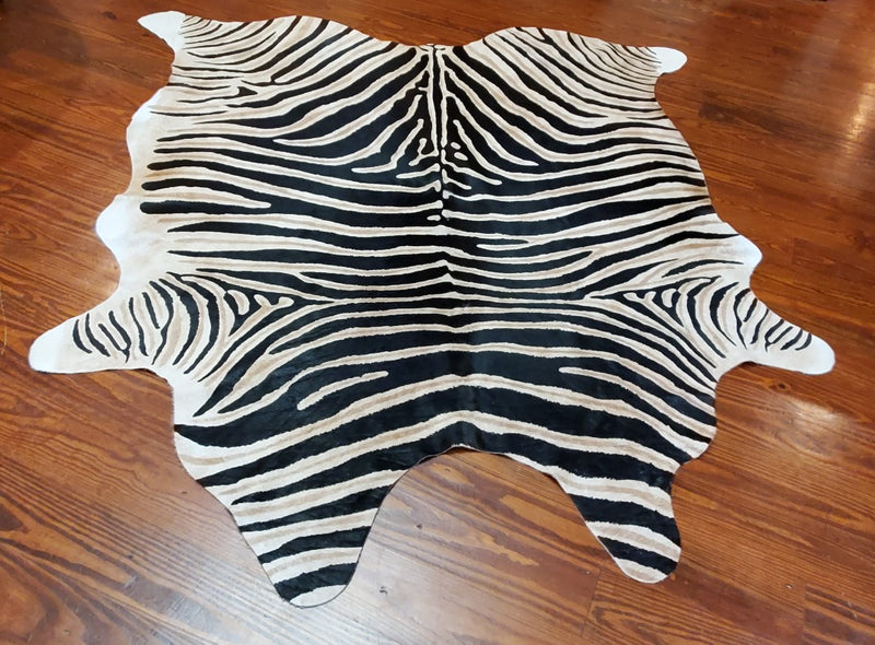zebra print on cowhide floor rug