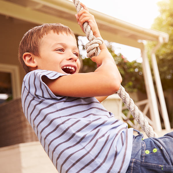 Child swinging on a rope