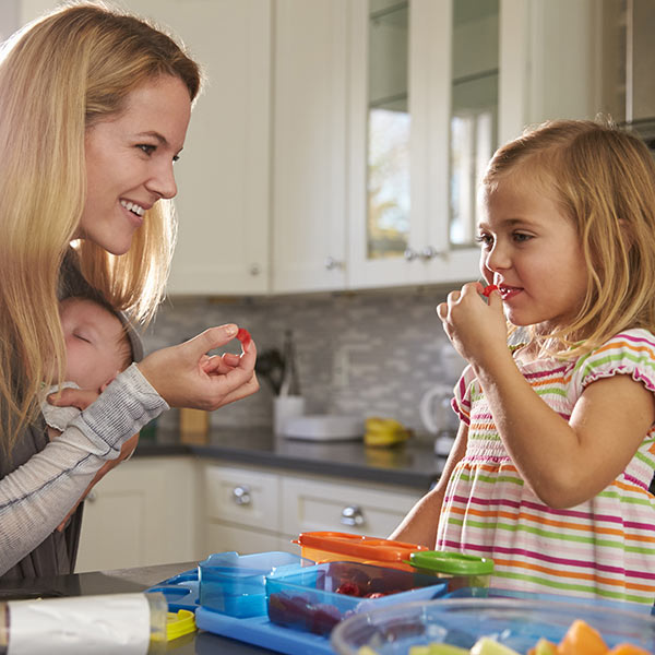 Mother and child in kitchen eating
