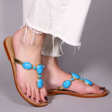 https://cdn.shopify.com/s/files/1/1089/1046/products/HILLSBORO-MYSTIQUE_SANDALS_HANDMADE_EMBELLISHED_LEATHER_WOMEN_S_THONG_FLIP_FLOP_SANDALS_WITH_TURQUOISE_STONES_360x.jpg?v=1591377444