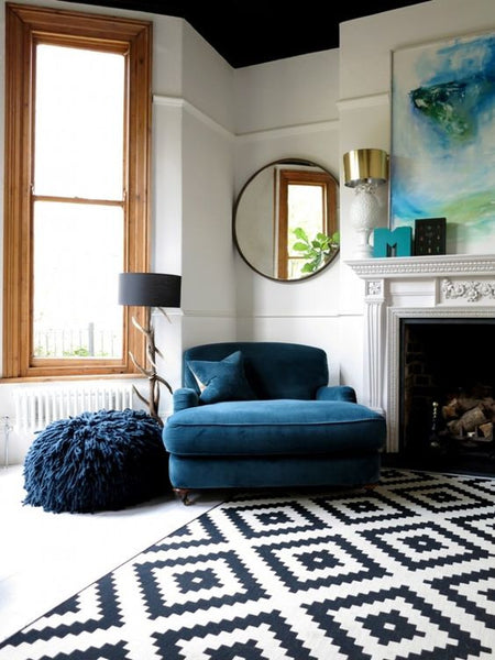 modern black and white rug in styled living room