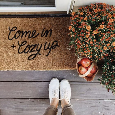 welcoming door mat