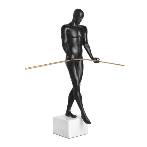 The Balancing Man Sculpture