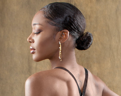 sleek and pulled back bun hairstyle