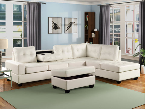 Faux white leather reversible tufted sectional with drop down cup holders and storage ottoman