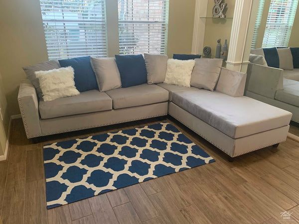 Modern style grey reversible sectional with nailhead trim
