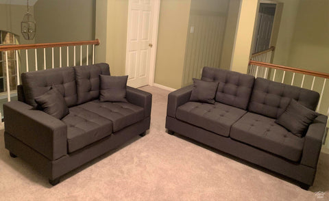 Gray tufted sofa and loveseat