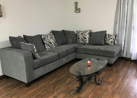 Charcoal Sectional includes throw pillows