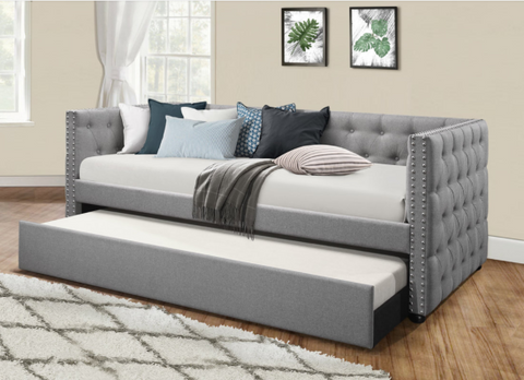Tufted grey twin daybed with twin trundle