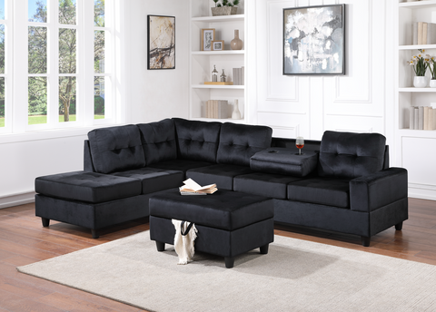 Black velvet reversible tufted sectional with drop down cup holders and storage ottoman