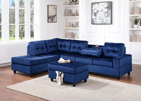 Blue velvet reversible tufted sectional with drop down cup holders and storage ottoman