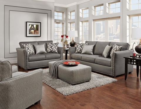 Elegant grey sofa and loveseat with nailhead trim