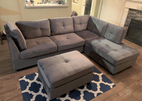 Silver (grey) velvet tufted sectional with nailhead accents and ottoman