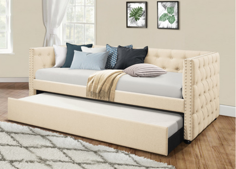 Tufted beige twin daybed with twin trundle