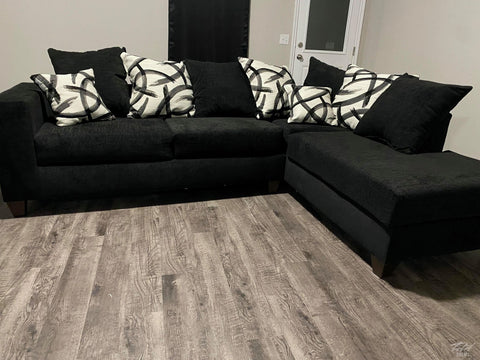 Black Sectional includes throw pillows