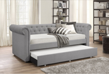 Grey twin daybed with twin trundle and nailhead design
