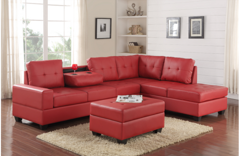 Faux red leather reversible tufted sectional with drop down cup holders and storage ottoman