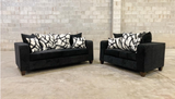 Black sofa and love seat with decorative pillows- new