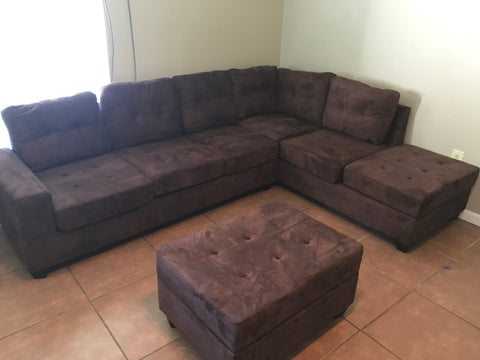 Chocolate reversible microfiber sectional with drop down cup holders and storage ottoman